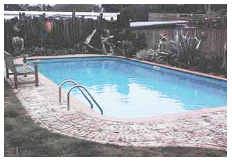 NICE OLD-STYLE LANDSCAPING AROUND MEDIUM SIZE POOL