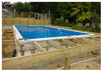 SEMI-ABOVE GROUND POOL TRANSFORMS SLOPING SITE