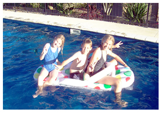 PHOTOALBUM/KIDS BOATING IN THEIR CASCADE SWIMMING POOL